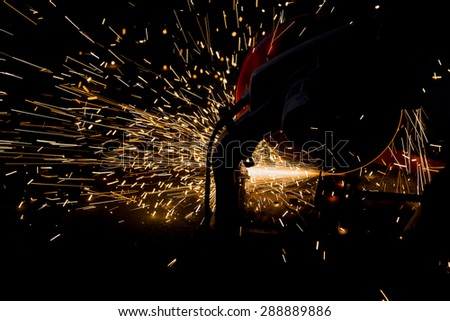 Sparks of bonfire while grinding iron - stock photo