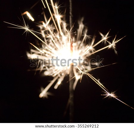 sparks sparklers in the dark closeup - stock photo