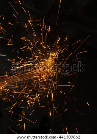 Sparks while cutting steel - stock photo