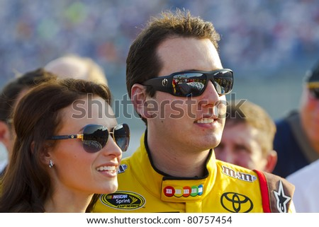 SPARTA, KY - JULY 09:  Kyle Busch (18) and Samantha Busch stand for the National Anthem before the Quaker State 400 race at the Kentucky Speedway in Sparta, KY on July 09, 2011. - stock photo