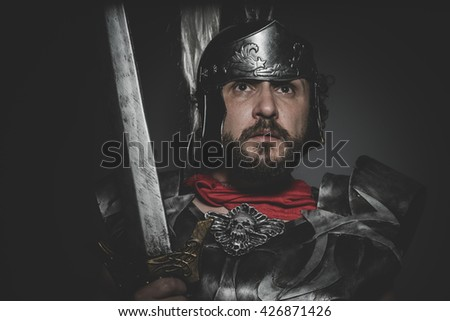 Spartan, Praetorian Roman legionary and red cloak, armor and sword in war attitude - stock photo