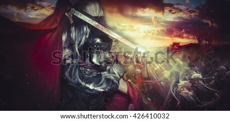 Spartan warrior helmet, armor and red cape on a battlefield, conflict and struggle in the Roman Empire - stock photo