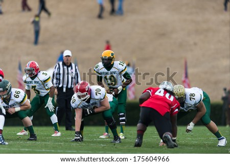 SPARTANBURG, SC - DEC 21, 2013 North Carolina QB Hasaan Klugh sets the offense - stock photo