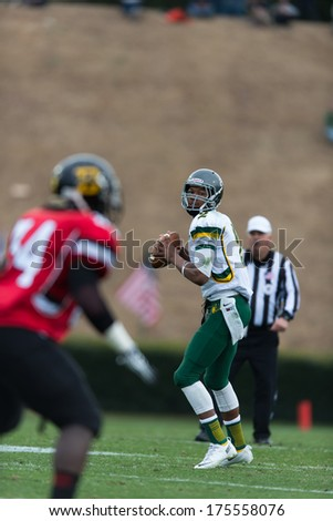 SPARTANBURG, SC - DEC 21, 2013 North Carolina QB Jalen McClendon looks for a receiver down field - stock photo