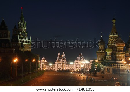 Spassky Tower and St Basil's Cathedral in Red Square at summer night in Moscow, Russia - stock photo