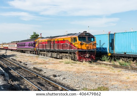 Spatial express train is moving pass the  container freight. - stock photo
