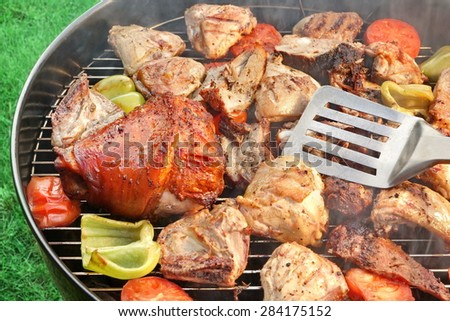 Spatula, BBQ Assorted Meat And Vegetables On The Hot Flaming Grill. Summer Outdoor BBQ Party Or Picnic Concept.