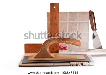 Spatula for finishing works, ceramic tile, square on a white background - stock photo
