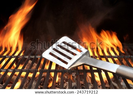 Spatula on the Barbecue Charcoal Fire Grill with Black Background - stock photo