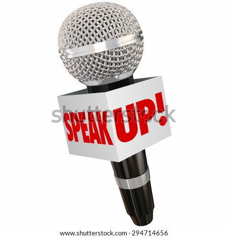 Speak Up words on a box around a microphone to illustrate sharing an opinion with a reporter or voicing feedback, anger or emotions in public