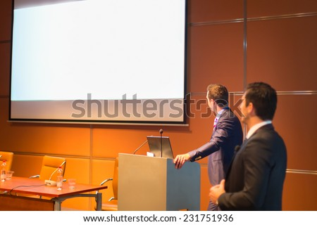 Speaker at Business Conference with Public Presentation. Entrepreneurship club. - stock photo