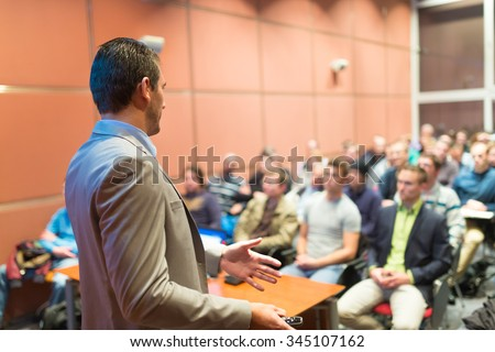 Speaker at Business Conference with Public Presentations. Audience at the conference hall. Business and Entrepreneurship concept. Background blur. Shallow depth of field. - stock photo