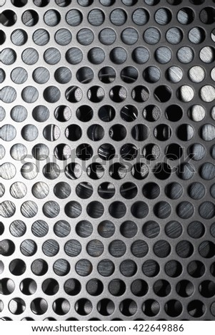 SPEAKER CONE WITH BLACK METAL GRILL ON TOP (FOCUS ON CONE NOT GRILL) - stock photo