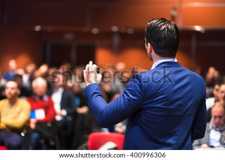 Speaker giving a talk on corporate Business Conference. Audience at the conference hall. Business and Entrepreneurship event. - stock photo