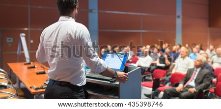 Speaker giving a talk on corporate Business Conference. Audience at the conference hall. Business and Entrepreneurship event. Panoramic composition. - stock photo