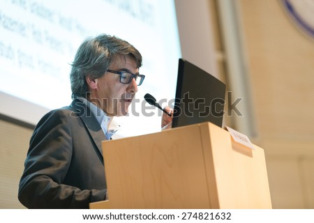 Speaker giving talk on podium at Business Conference. - stock photo