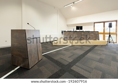 Speaker's table in modern conference hall