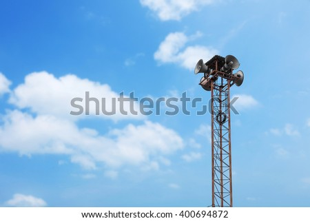 Speaker tower on blue sky background.