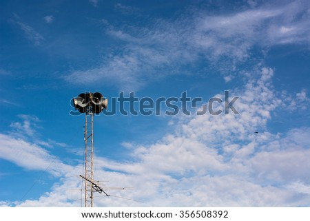 Speaker tower with blue sky