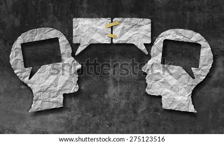 Speaking together social media concept as two crumpled pieces of paper shaped as a human head with talk bubble icons taped as a communication symbol for business  and compromise agreement. - stock photo