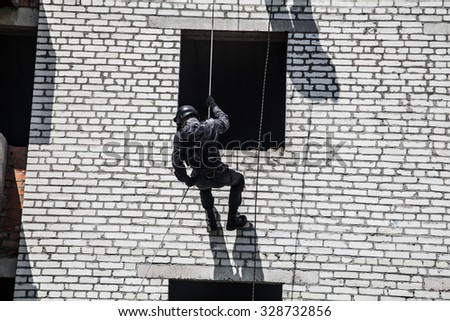 Spec ops police officer SWAT during assault operation - stock photo