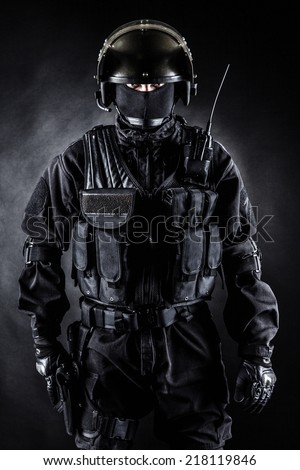 Spec ops soldier in uniform on black background - stock photo