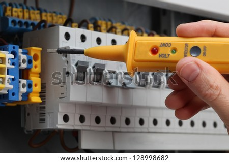Special detector for checking the voltage in switchboard - stock photo
