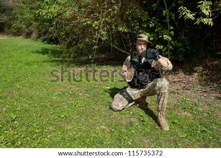 """Special Forces soldier charged gun, assault rifle """"sa.58"""" - stock photo"""