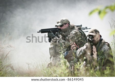 special forces soldiers in smoke - stock photo
