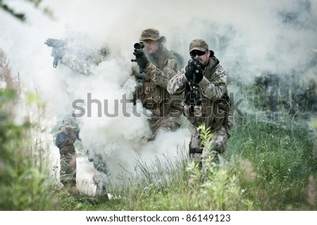 special forces soldiers walking in smoke - stock photo