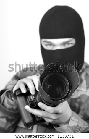 Special Ops Photographer. Lens hood and front of lens are in focus, rest is soft . B&W - stock photo