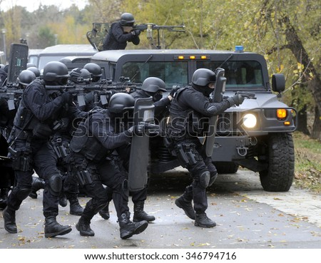 Special police team in action - stock photo