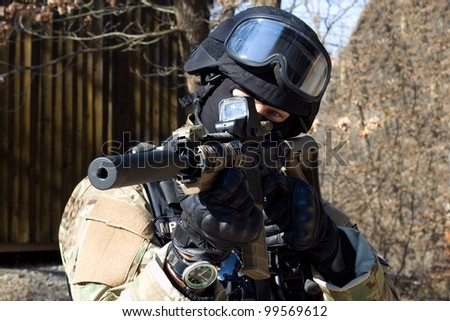 special police unit, masked police officer with a weapon - stock photo