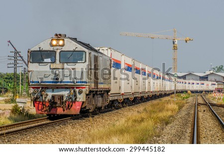 Special trains International cargo Nippon Express BangSue  - Padang Besar, Malaysia, the locomotive of the train by Toshiba Class 24 No. 24119 - The container freight No.781 23 February 2014. - stock photo