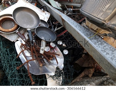 special waste dump with old rusty iron pieces and nets - stock photo
