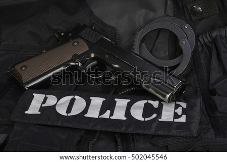 Special weapons and tactics police team equipment on black background