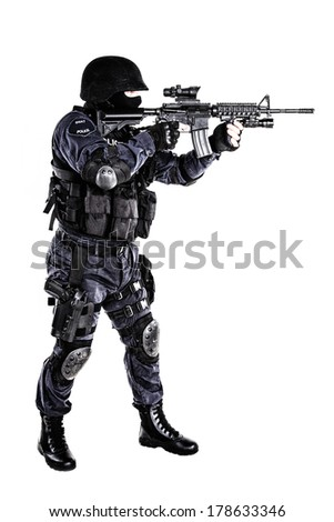 Special weapons and tactics (SWAT) team officer with his gun - stock photo