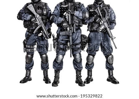 Special weapons and tactics SWAT team officers with guns - stock photo