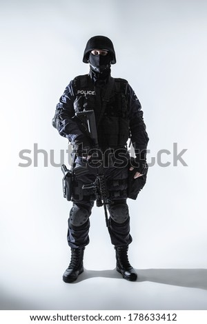 Special weapons and tactics team officer with his gun - stock photo