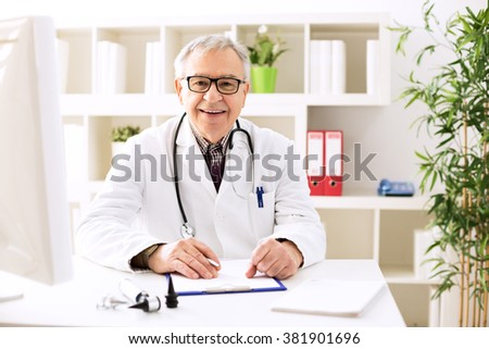 Specialist doctor otologist in office - stock photo