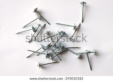 Specialize nail that used with galvanized iron roof , normally used in rural area of Thailand. - stock photo