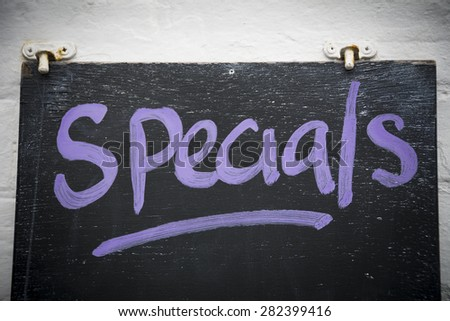 Specials on blackboard - stock photo