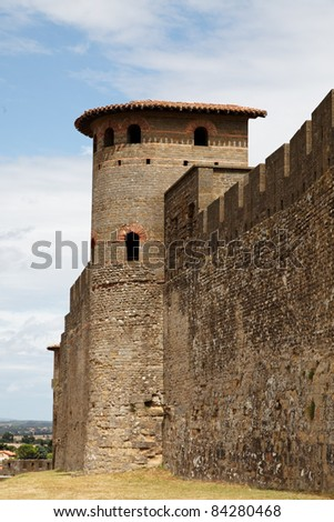 Specific tower and wall detail from the fortified city of Carcassonne in Uade department of France.
