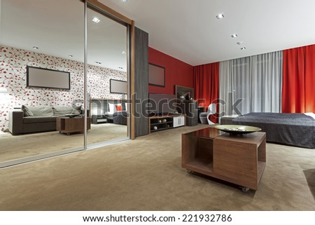 Specious hotel bedroom interior in the evening