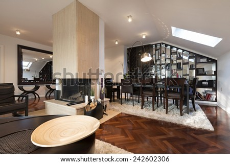 Specious loft apartment interior with fireplace - stock photo