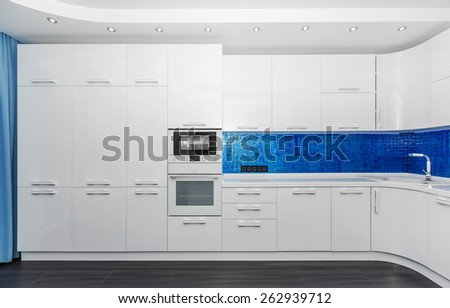 Specious modern white blue interior kitchen-dining room with the built-in household appliances