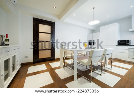 Specious white dining room interior - stock photo