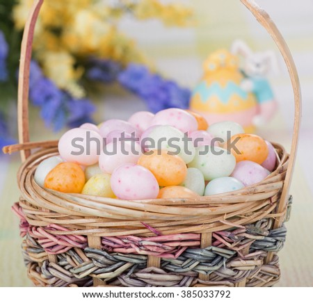 Speckled Easter egg candy in a basket - stock photo