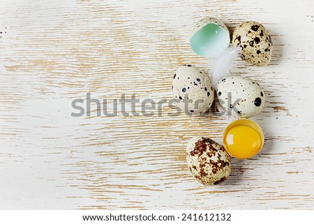speckled quail eggs on a rustic background - stock photo