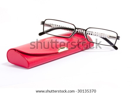Spectacle-case with glasses over white background